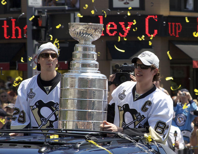 Pittsburgh Penguins players Marc-Andre Fleury and Sidney Crosby hold the Stanley Cup during the celebration parade Downtown in 2009.
