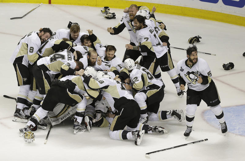 Pittsburgh Penguins players celebrate after beating the San Jose Sharks in Game 6 of the NHL hockey Stanley Cup finals in San Jose, Calif. Sunday, June 12, 2016. The Pens won 3-1 to win the series 4-2.