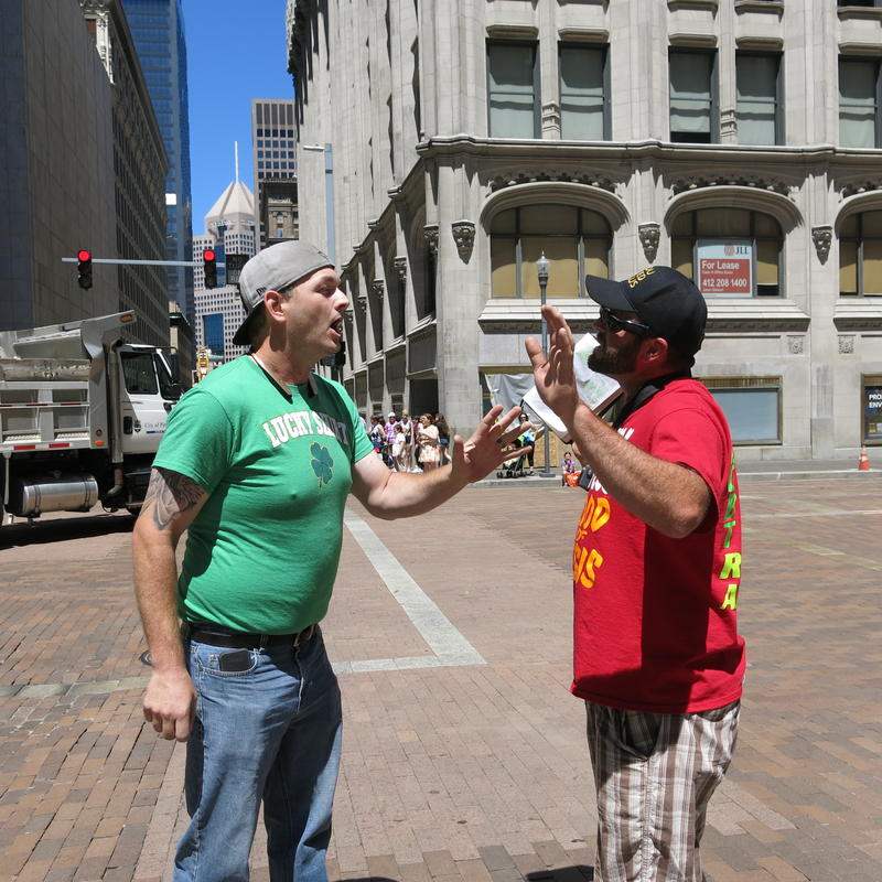 Joe Kiser from Pittsburgh argues with a street preacher. Kiser said he was raised by two women and supports equality for all.