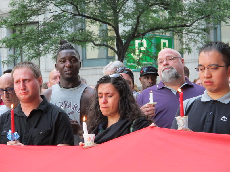 Some people at Monday's night's vigil were brought to tears as the names of the victims of the mass shooting in Orlando were read aloud.
