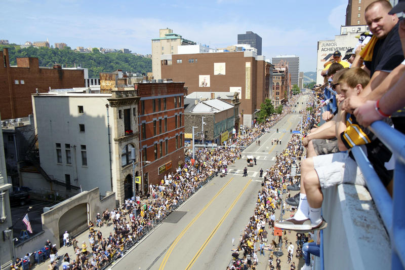 Fans cluster along all five levels of a parking garage on Boulevard of the Allies to get a good view of the Pittsburgh Penguins' Stanley Cup celebration parade on Wednesday, June 15, 2016.