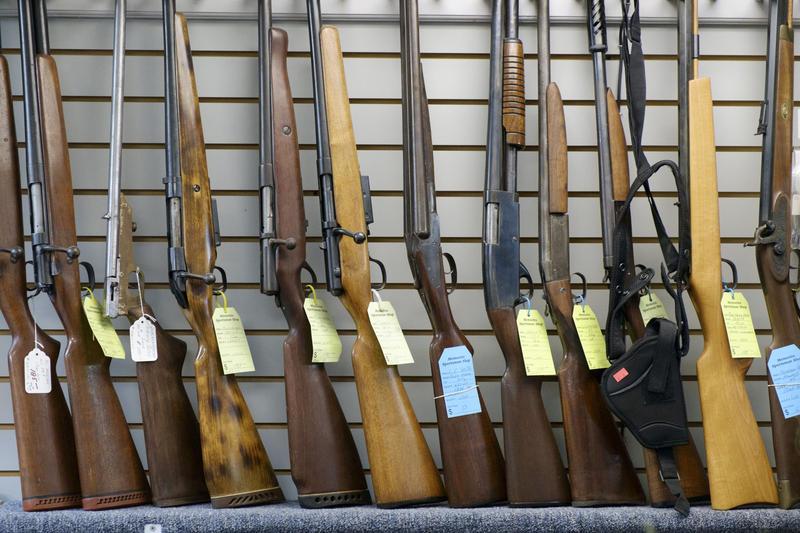 Guns line the wall at Memories Sportsman Shop & Taxidermy in Sharpsburg on June 17, 2016.