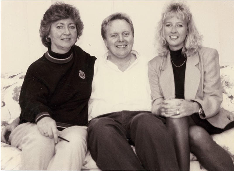 PATF employees Cathy Eller and Mary Hawk pose with Jones in 1995.