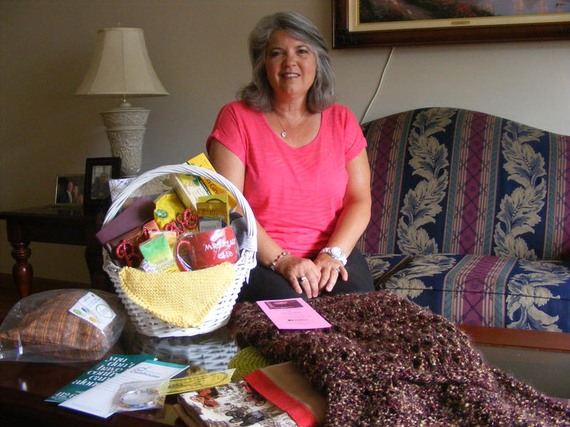 Mrs. Claus Club of the North Hills founder Jeana Watenpool in her home where she puts together the comfort baskets that she gives to cancer patients.