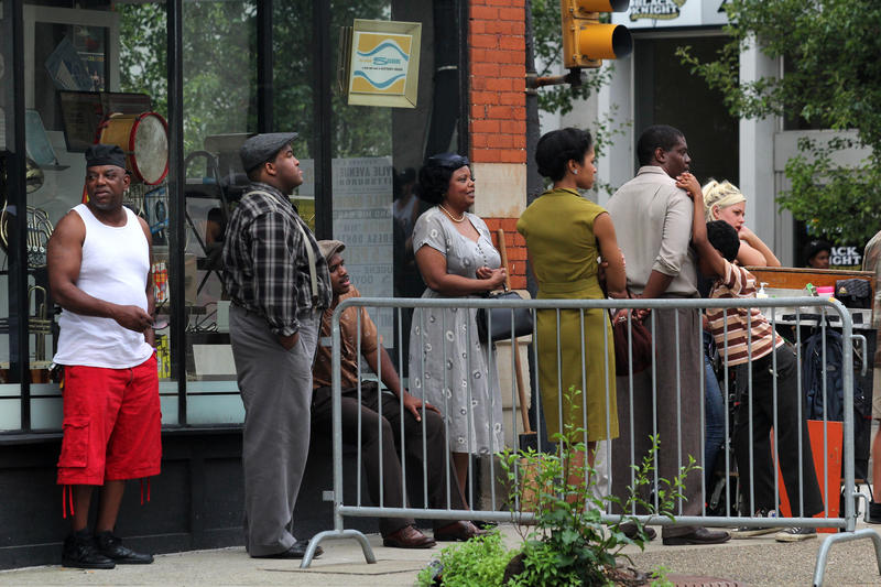 "Extras wait between scenes during the filming Denzel Washington's adaptation of August Wilson's ""Fences"" in Pittsburgh's West End on Friday, June 3, 2016."