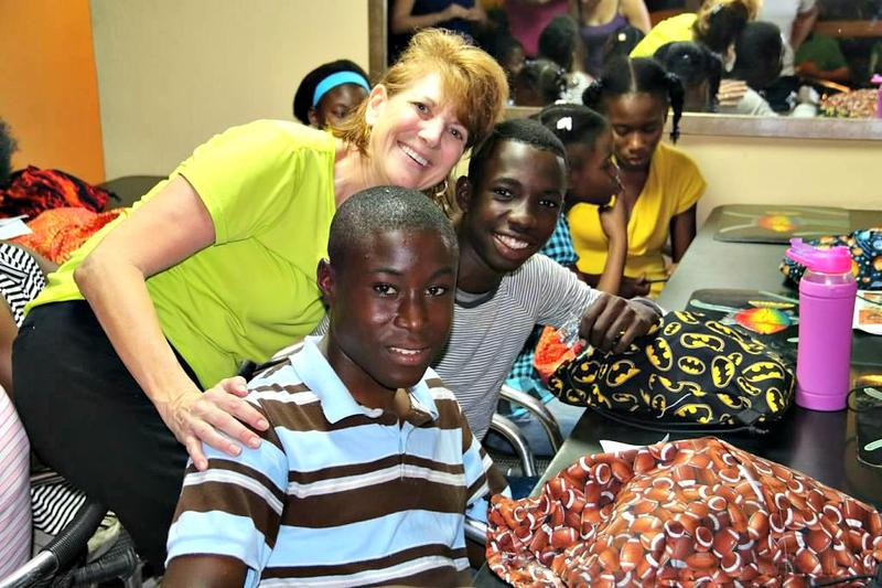Denise Ford poses with children at Yahve-Jire Children's Foundation's orphanage in Haiti.