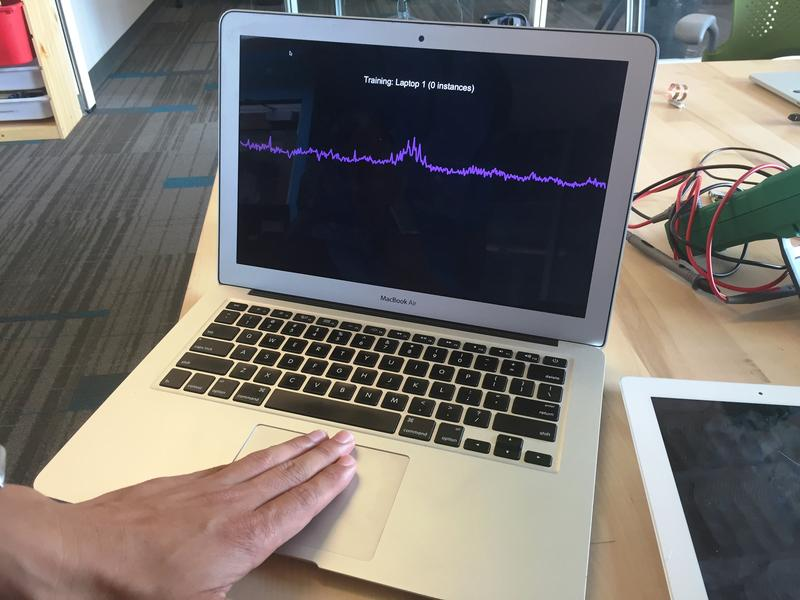 CMU PhD student Gierad Laput shows his laptop's reaction to his touch. The technology can recognize which objects come in contact with others, which Laput says can be helpful when creating the so-called 'Internet of Things.'