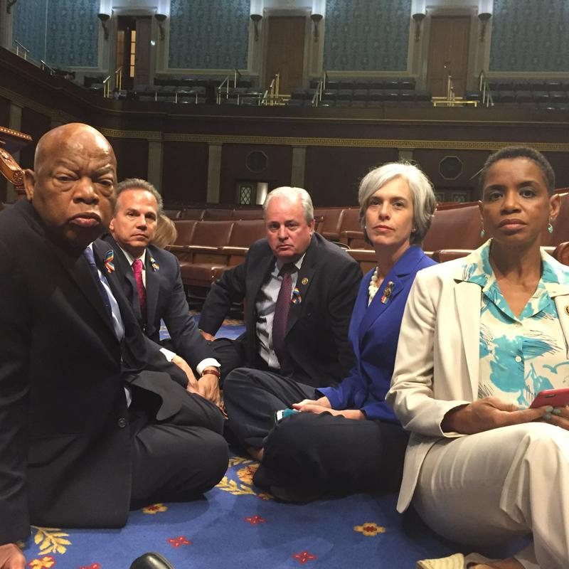 Democratic Representatives, including John Lewis (D-GA) and MIke Doyle (D-PA) sit on the House floor protesting the GOP's refusal to vote on gun safety legislation.