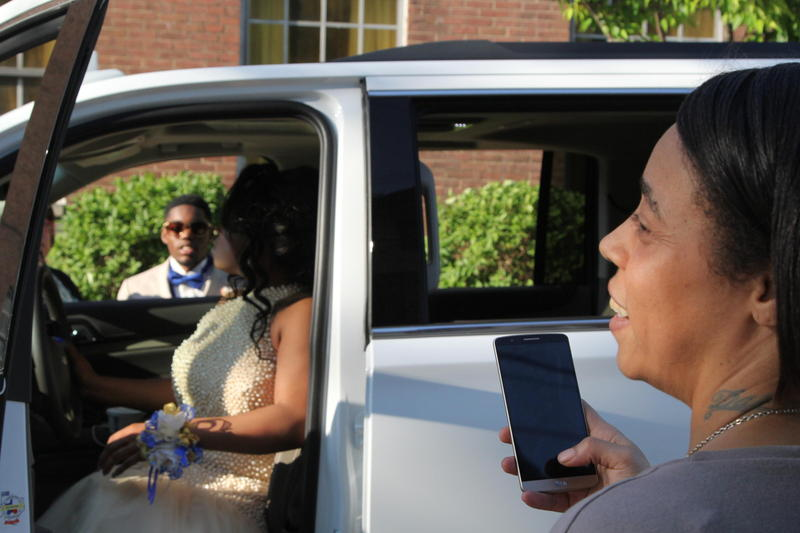 Shadaka Robinson takes pictures of her daughter Shadai and her prom date Bill.