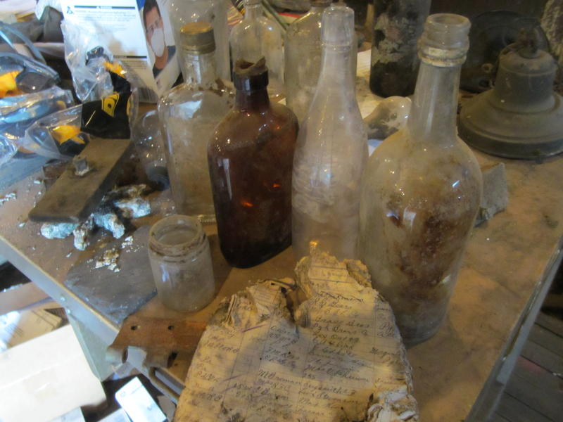 Bottles, schedules and other artifacts found in the Coraopolis train station.