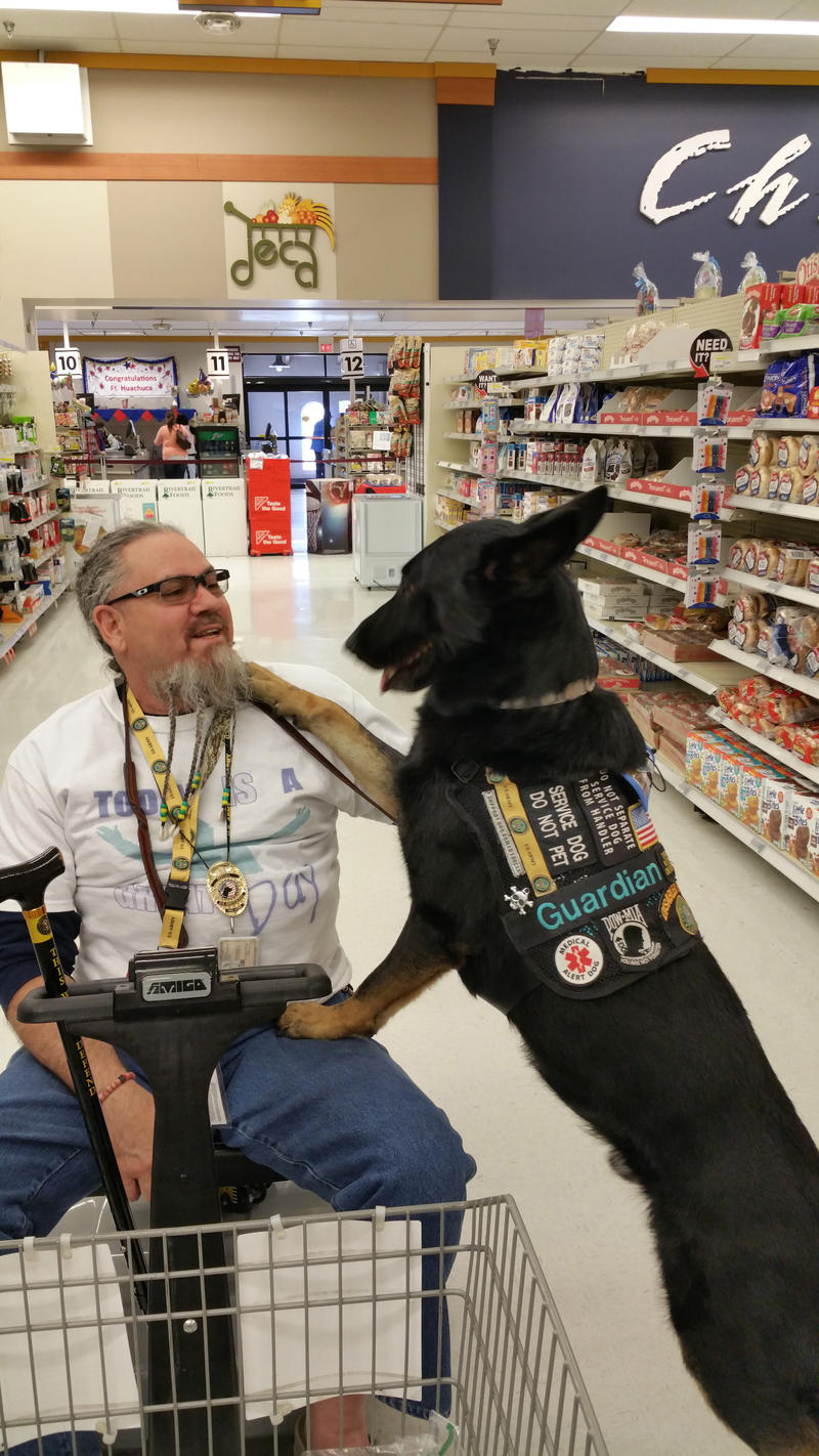 Rudy Lorie and Rocket interact at a supermarket during a trip to Fort Huahuca, Az. in April 2016.