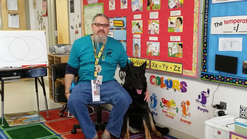 Rudy Lorie, 61 of Ocala, Fl, and his service dog rocket visit Colonel Johnston Elementary School in Fort Huahuca, Az. on April 8, 2016. Lorie, a U.S. army veteran recieved his service dog through Guardian Angels.