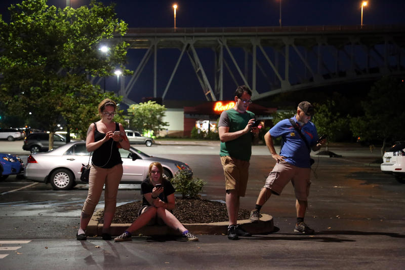 Pittsburghers Brittny Kephart, 26; Toni Weible, 28; Jared Trausi, 28; and Tom Higgs, 33, stop beside TGI Fridays in the Waterfront to catch Pokemon. Higgs said he and his friends have spent nearly 100 hours on the game since it launched last week.