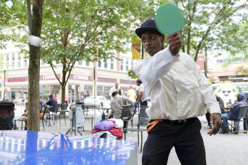 Rob Johnson of the East End responds to a serve during a ping-pong match in Market Square.