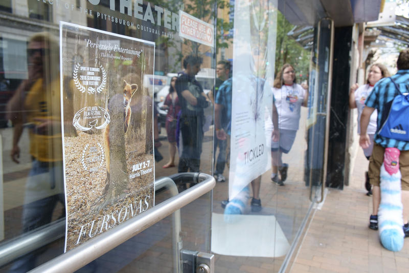 A poster for the documentary Fursonas hangs on the front doors of the Harris Theater on Friday, July 1, 2016. The film centers on furry culture and its latest screening runs in tandem with this year's Anthrocon.