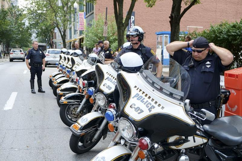 Pittsburgh Police ready their motorcycles on Penn Avenue Downtown before the People's March, an event coordinated with the start of the People's Convention on Friday, July 8, 2016.