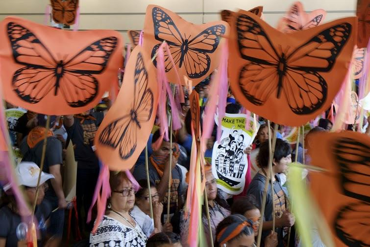 Activists wave butterfly banners inside the David L. Lawrence Convention Center on Friday, July 8, 2016.