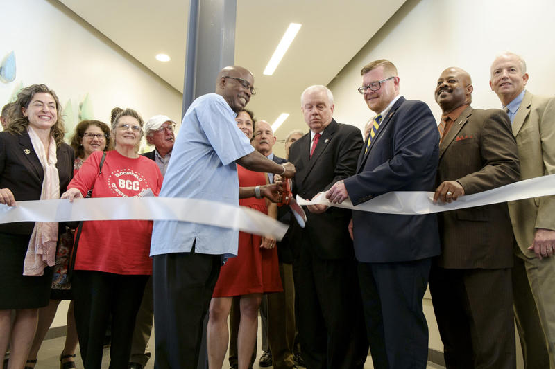 A ceremonial ribbon-cutting takes place during the official opening of ACTION-Housing's new affordable living spaces in the lobby of the Penn Mathilda Apartments in the East End on Monday, July 18, 2016.