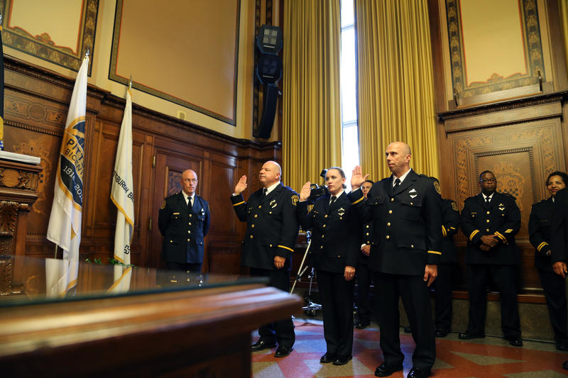 Commander Cristyn Zett takes a new oath of office at the Pittsburgh Bureau of Police promotion ceremony held Monday, July 11, 2016. Zett was tapped to take and teach an implicit bias training course funded by the U.S. Department of Justice.