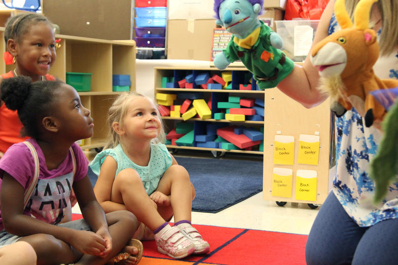 Kahmille Wallace, left, and Charlotte Logel interact with the characters of Three Billy Goats Gruff Wednesday August 3, 2016 at Roosevelt Elementary School.