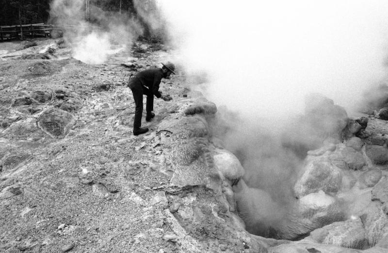 Geologist Rick Hutchinson watches over one of his charges, a steam hole in Yellowstone National Park, Wyoming, on Aug. 4, 1978. Thermal rangers take water samples, chart eruptions, monitor temps and keep clean the park's roughly 10,000 thermal features.