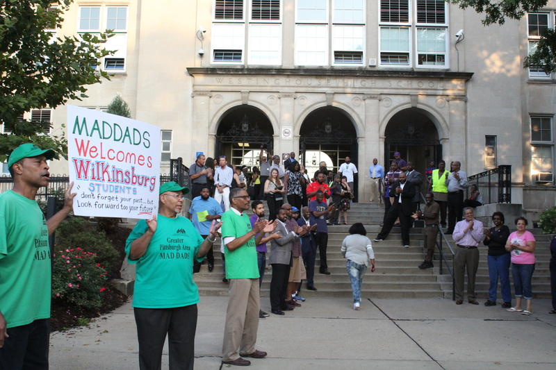 Community members and teachers line the steps of Westinghouse Academy in Homewood to greet students on the first day of school.