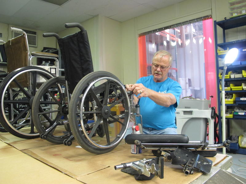 Global Links volunteer Chris Meyer spends several hours a week repairing and cleaning donated wheelchairs to send to those in need.