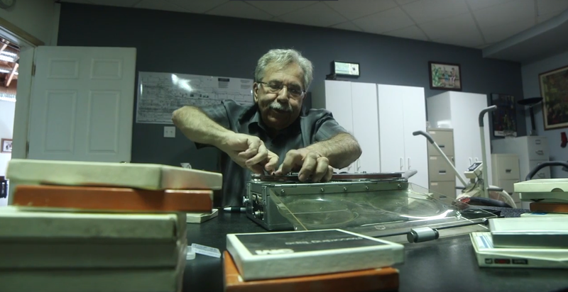 Braddock filmmaker Tony Buba looks through his tapes from the 70s and 80s. Buba has produced a number of films about his hometown,