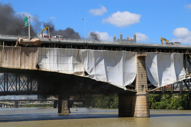 Thick, black smoke billowed from plastic tubing that caught on fire during the Liberty Bridge deck replacement.