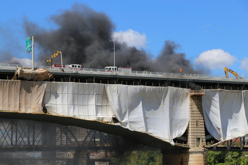 Fire trucks arrived to the Liberty Bridge where workers were replacing the deck. As they torched the beams, sparks fell onto plastic piping below and caught fire.