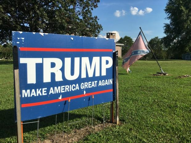 A Trump yard sign and tattered Confederate flag in Carmichaels.