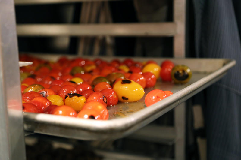 Roasted tomatoes cool on a rack in a shared corner between Provision PGH and Carota Cafe. With only 144 square feet per kitchen, space and efficiency are paramount, Chef Stephen Eldridge said.