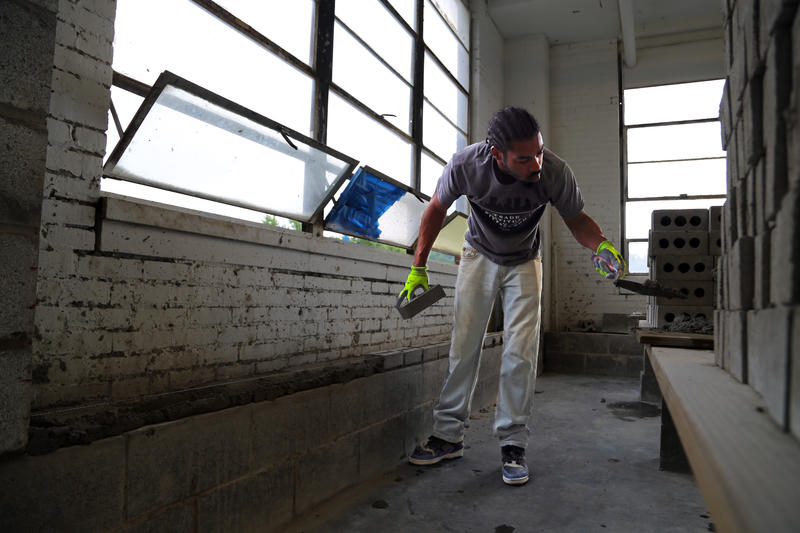 "Pittsburgh native Jeff Jackson, 28, says bricklaying at the Trade Institute of Pittsburgh centers him. ""Whatever I'm going through in my day and week, it all goes into these bricks. When I leave here, I'm a better man."""