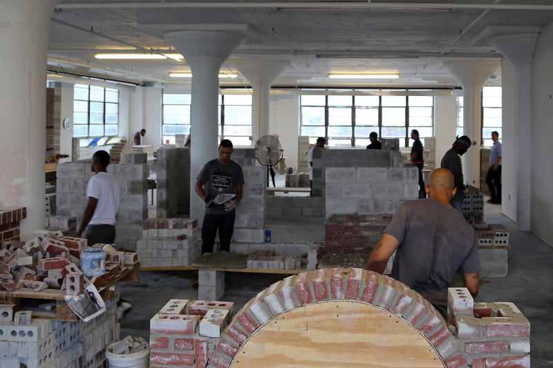 Masonry students at the Trade Institute of Pittsburgh use and reuse the same tools, bricks and faux mortar to build walls, small projects and a square, 16-foot-8 house inside the third floor of the old Westinghouse building in Homewood.