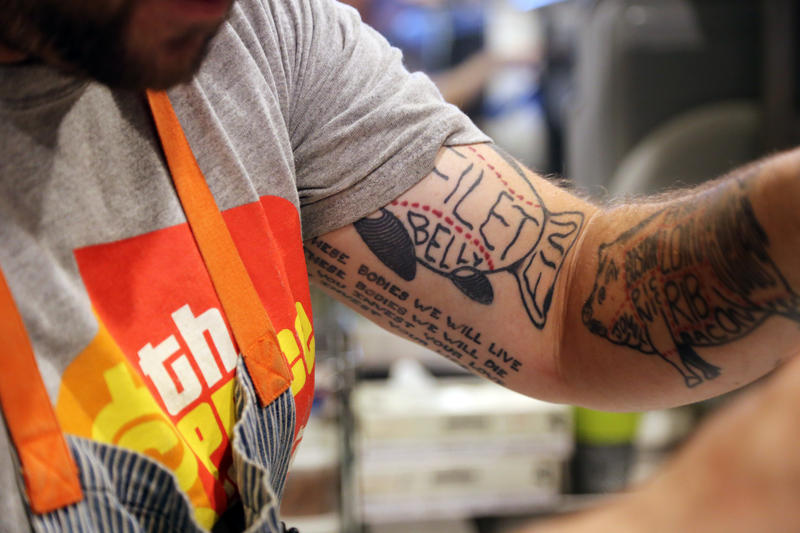 Chef Stephen Eldridge, 40, of Swissvale shows off his eclectic tattoos while beating duck eggs in his Provision PGH kitchen Tuesday, Aug. 16, 2016. The ink depicts animals dissected by cut, many of which are often found on his budding restaurant's plates.