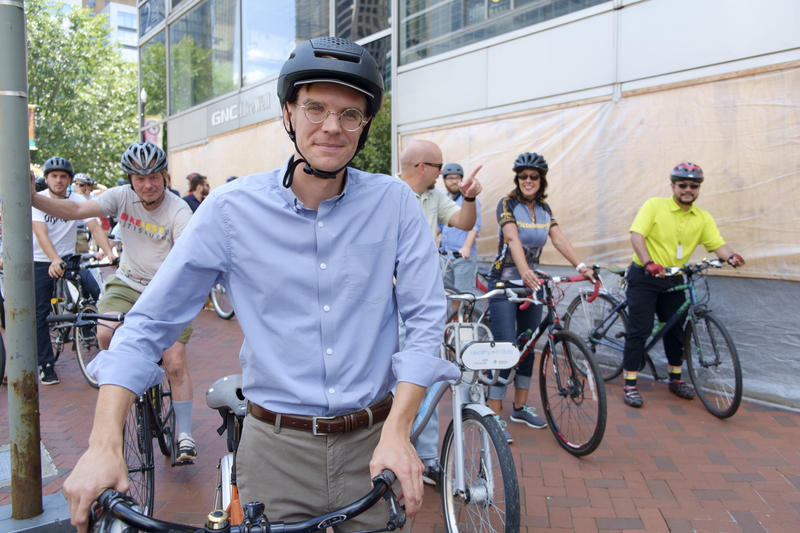 Dan Yablonsky, 27, of Bloomfield, gathers fellow bicyclists in Market Square before embarking on the Lunch Loop, a short Downtown bike trip, on Tuesday, Aug. 23, 2016. Yablonsky is the business development manager for Bike Pittsburgh.
