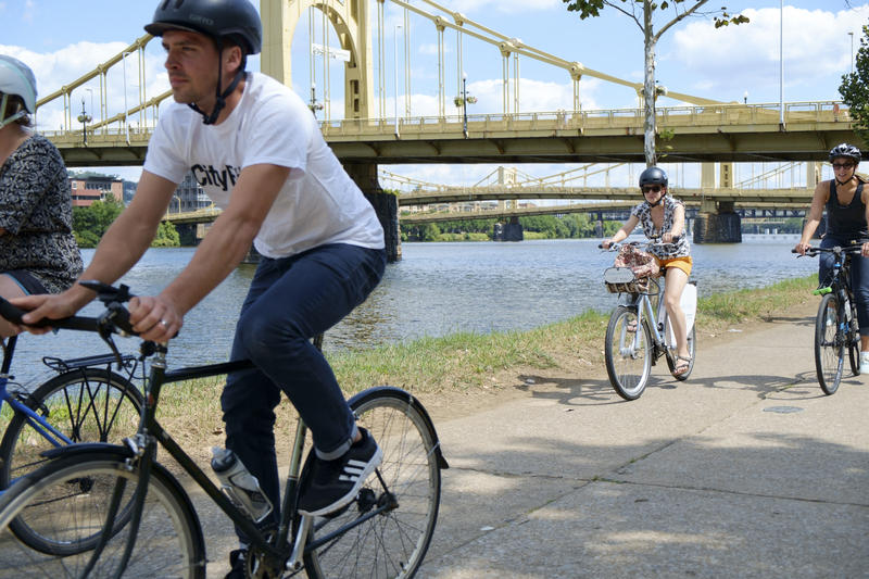 Bicyclists participating in Bike Pittsburgh's Lunch Loop ride along the Allegheny Riverfront on Tuesday, Aug. 23, 2016.