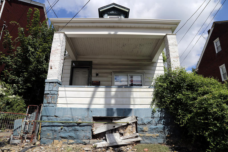 A blighted house on Woodland Avenue in the Marshall-Shadeland neighborhood of the North Side. The house will be redeveloped soon with help from the Northside Leadership Conference.
