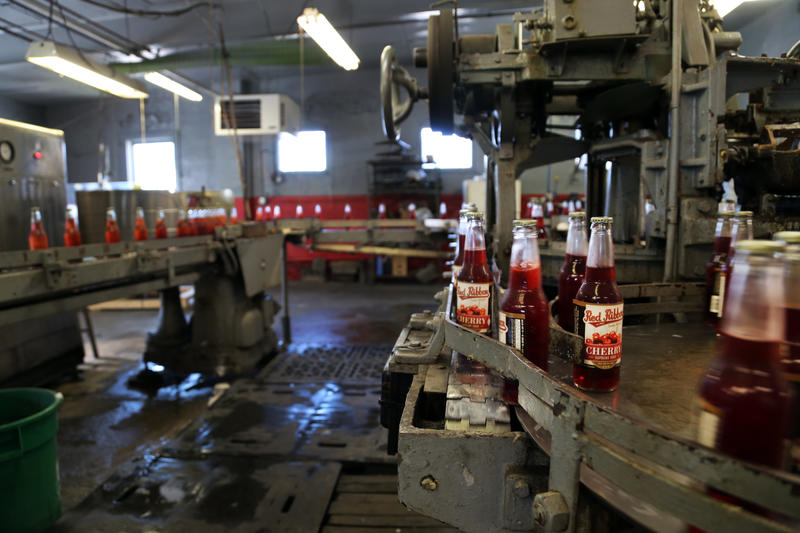 Freshly labeled cherry supreme soda comes off the line at the Natrona Bottling Company on Wednesday, Sept. 14, 2016.