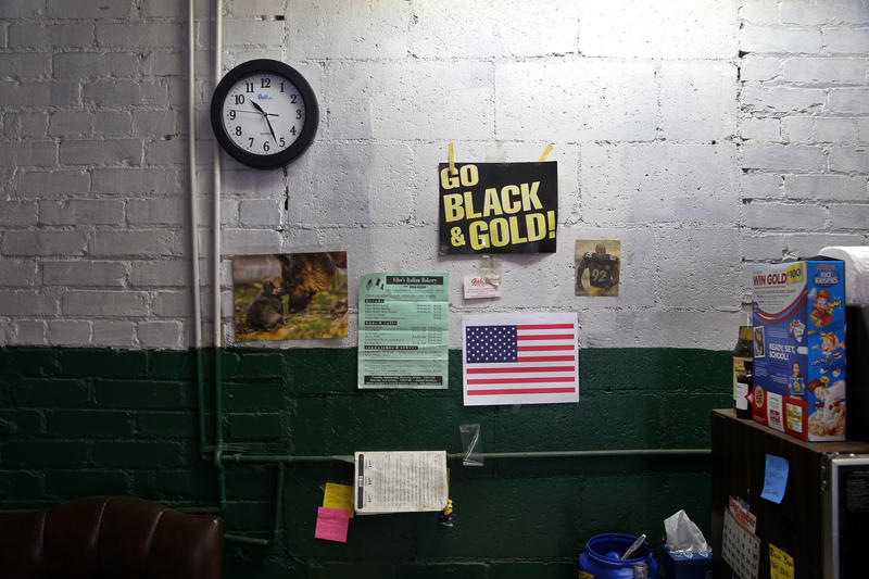 Hines Ward, puppies and restaurant menus are tacked to the wall of a small break area inside the Natrona Bottling Company on Wednesday, Sept. 14, 2016. The 112-year-old company found a home in an old automotive garage in Natrona Heights.