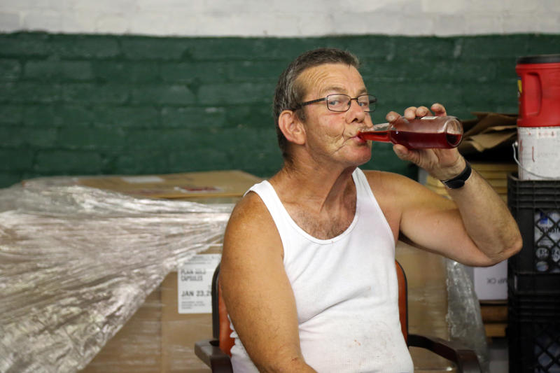 "Helper Robert Filows, 57, rests in a small break area at the Natrona Bottling Company on Wednesday, Sept. 14, 2016. Filows started there part-time in his early 20s and often packs the cardboard cases. ""Flavor don't matter,"" he said. ""It's all good to me."""