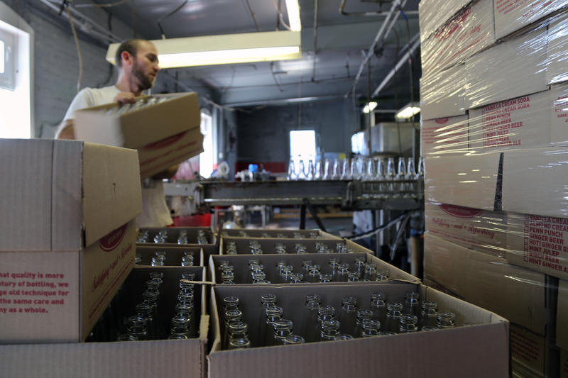 Dave Knapp, 30, of Leechburg loads clean, empty bottles onto the conveyor at the Natrona Bottling Company on Wednesday, Sept. 14, 2016. Knapp helps out between gigs roofing and in restaurants, he said.
