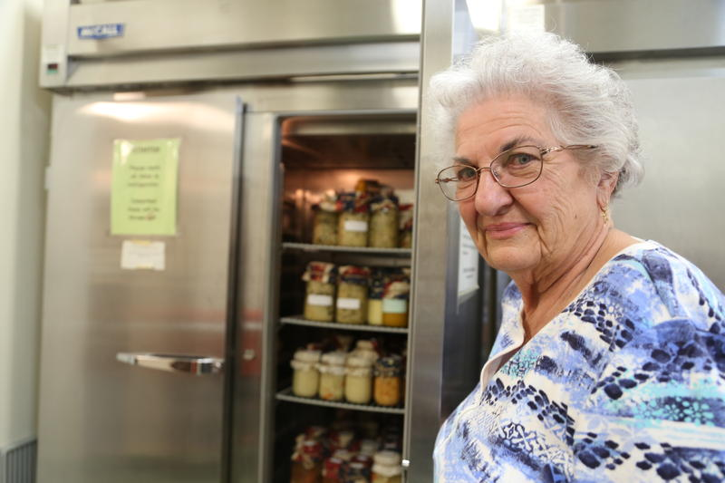 Mary Lou English stands in front of a fridge stacked with soup to be sold on Election Day. She says she and several other volunteers made about 120 pints of soup Monday afternoon.