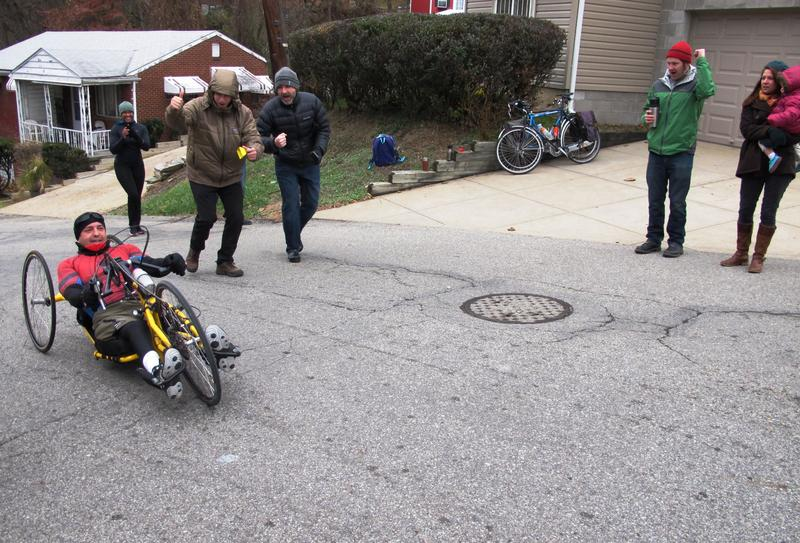 Attila Domos, 48, a friend and training partner of Danny Chew's, finishes the third hill, Christopher St. in Stanton Heights on November 26, 2016. Domos is paralyzed from the waist down and this was his second attempt at the Dirty Dozen on a hand cycle.