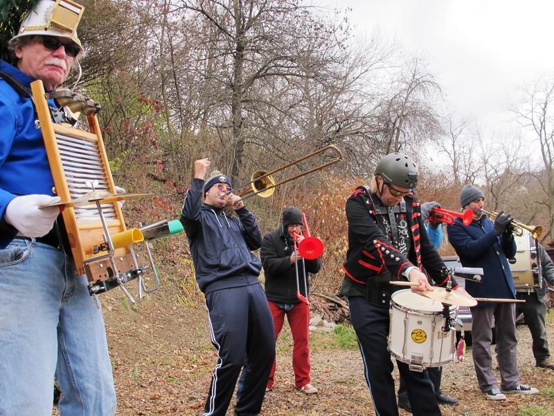 Colonel Eagleburger's Highstepping Goodtime Band amps up the crowd and riders at Canton Ave. in Beechview on November 26, 2016.