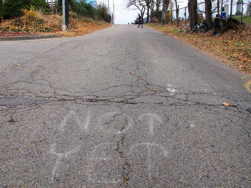 A message in chalk 100 feet from the finish line of the Dirty Dozen on Tesla St. in Hazelwood on November 26, 2016.