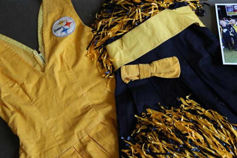 Many years, the Steelerettes made their own costumes. This outfit belongs to 1964-65 Steelerette Valerie Miller (Mafrice). She said the girls usually had to sew on the Steelers' logo themselves.