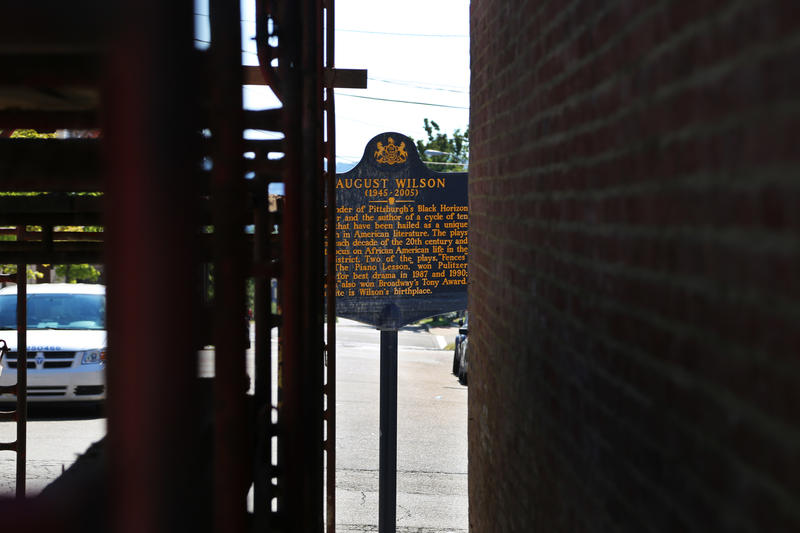 A placard outside the childhood home of Pittsburgh playright August Wilson viewed between a newly reinforced brick wall and the scaffolding beside it on Thursday, Sept. 22, 2016. The building is one of several undergoing renovations in the Hill District.