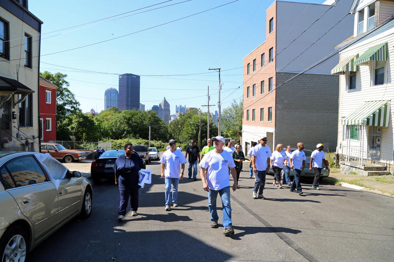 "Terry Baltimore (left) leads a group of PPG volunteers through the Hill District on Thursday, Sept. 22, 2016. Baltimore says it's her mission to change the pervasive negative impression of Pittsburgh's ""H"" neighborhoods."
