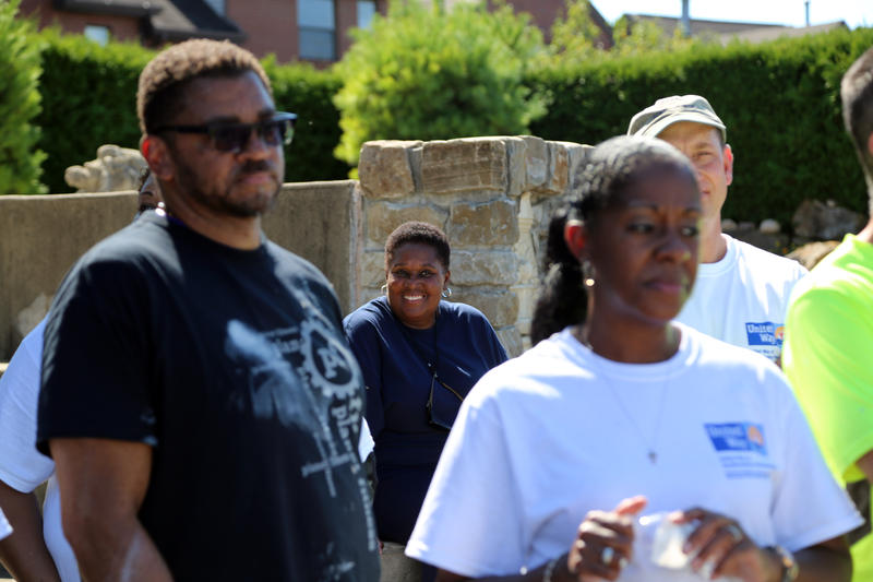 Neighborhood advocate Terri Baltimore smiles through a small crowd of PPG employees on a tour through the Hill District on Thursday, Sept. 22, 2016.